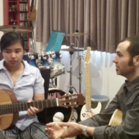 Viv And Gary in a Guitar Lesson